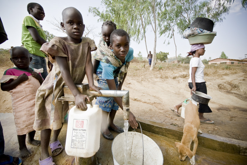 Villagers collect water, Kayelekera Village, Malawi, 2009. Photo by Jessie Boylan